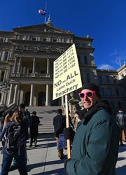 "Dan Cancro of Detroit marches in front of the Capitol on Dec 4, 2018, as demonstrators protest legislation being considered in the ""Lame Duck"" sessions of the House and Senate."