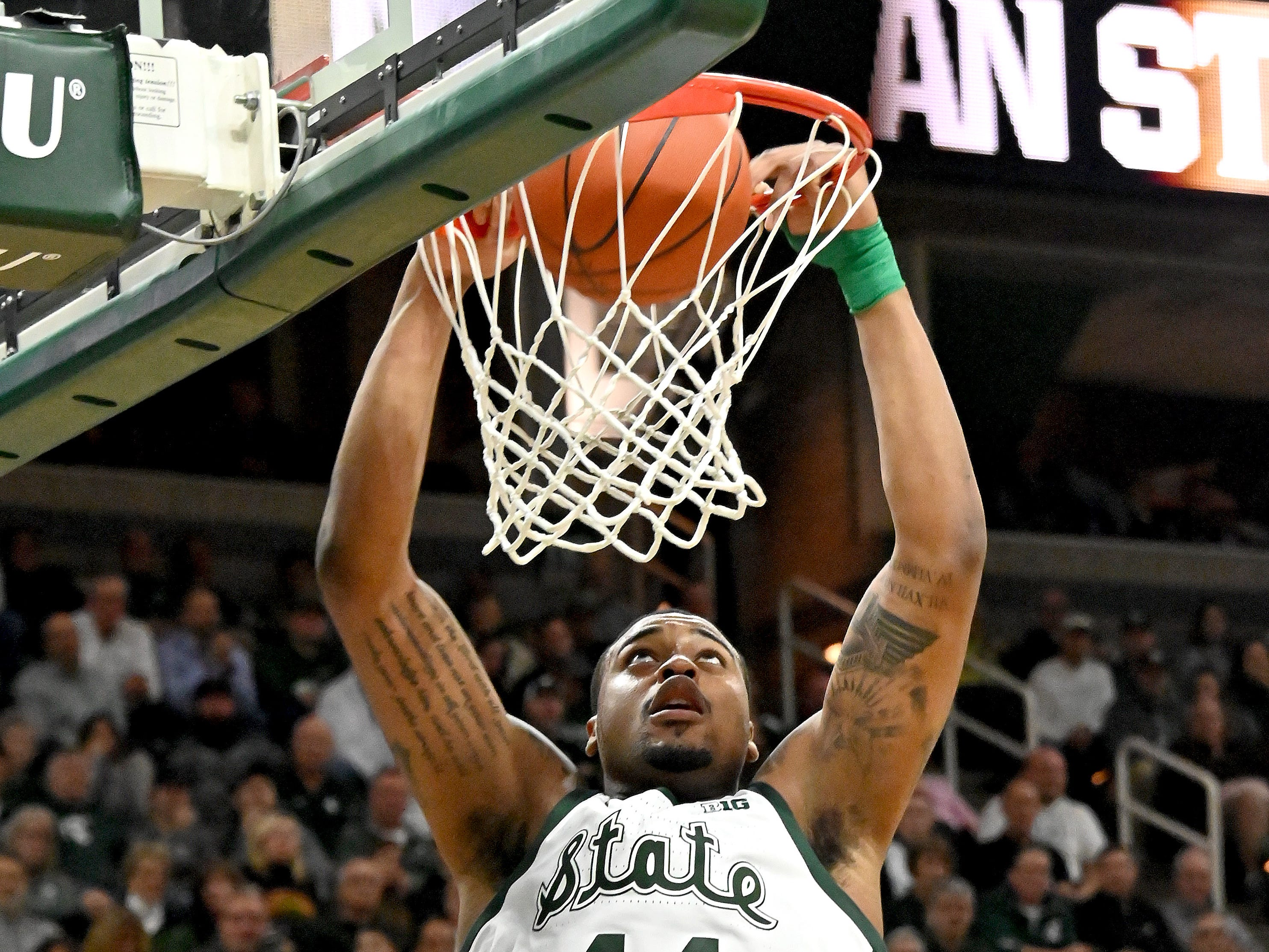 Nick Ward flushes the ball through the hoop in the second half.
