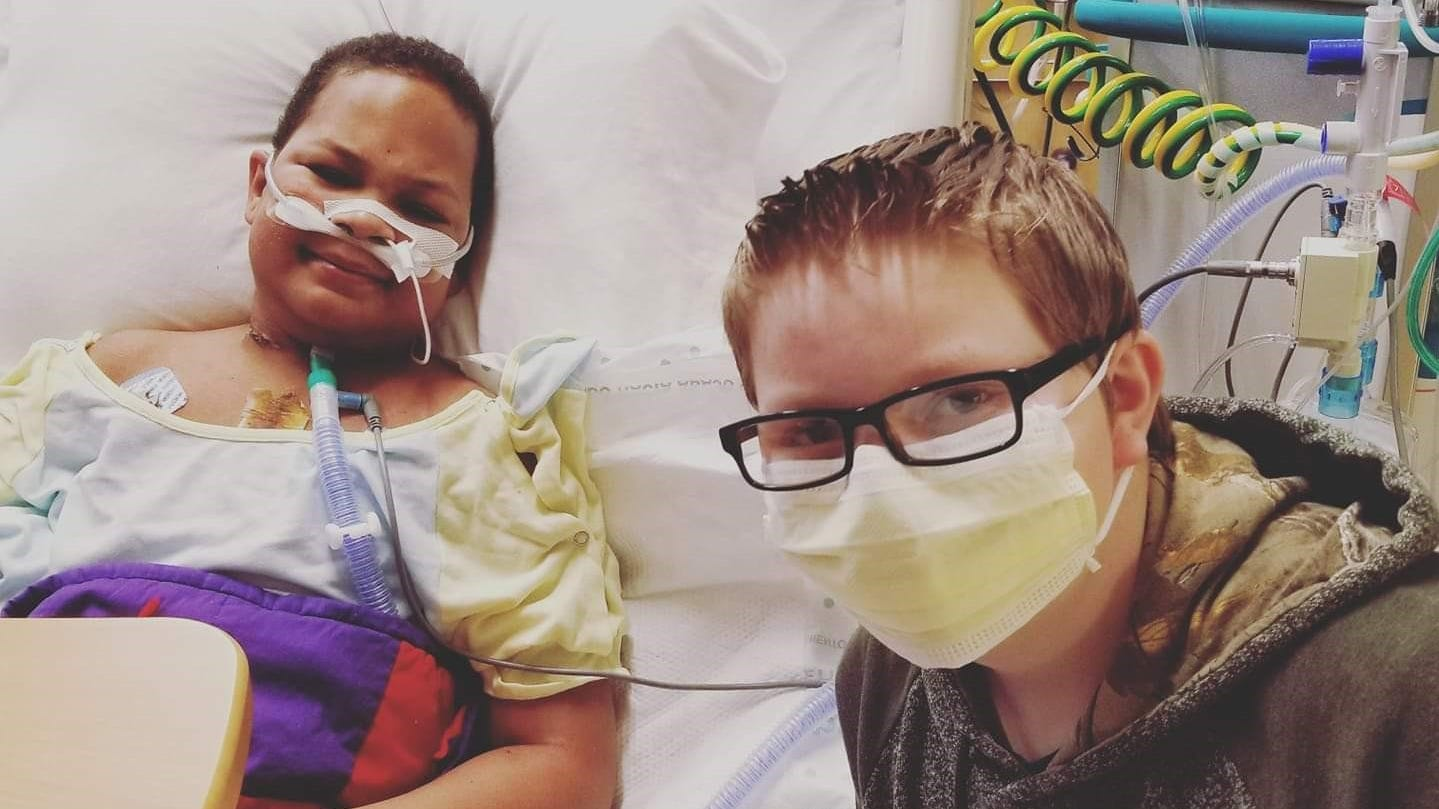 """Kaleb Klakulak, right, visits his best friend Kenneth """"K.J."""" Gross in his room at Children's Hospital, where K.J. was laid up from January 4 until May 1, when he died from congestive heart failure."""