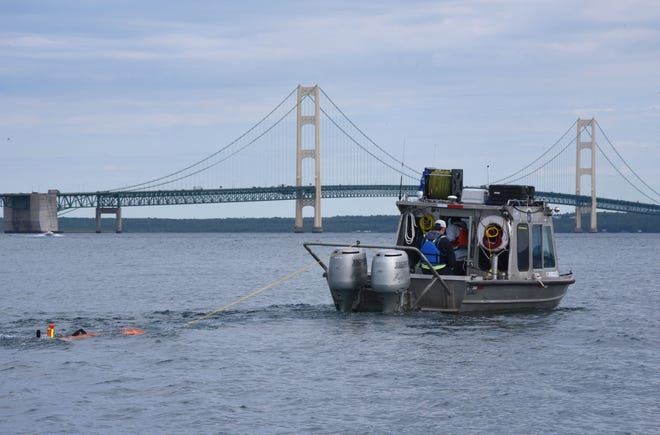Oil pipeline operator Enbridge tows their autonomous underwater vehicle toward the Mackinac Bridge and west to inspect their controversial Line 5 under the Straits of Mackinac Wednesday, June 8, 2016. Using the autonomous underwater vehicle and a roving underwater vehicle over several days, the entire five-mile-long pipeline, which rests on supports along the bottom of Lake Michigan, will have been covered by both sonar and visual means.
