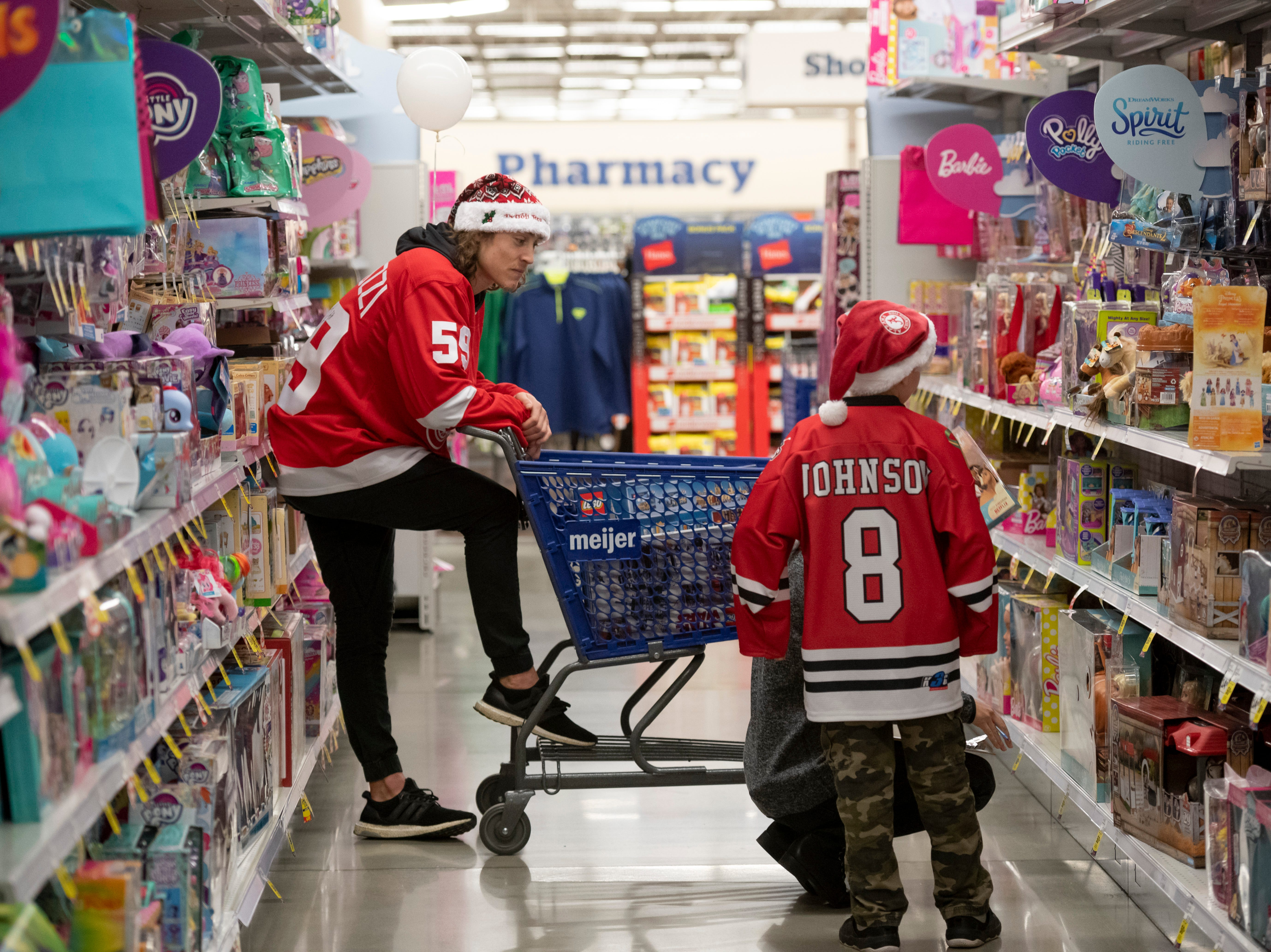 Detroit Red Wing forward Tyler Bertuzzi participates in the team's annual Hometown Holiday Assist shopping spree.