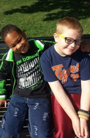 "During healthier and happier days, Kenneth ""K.J."" Gross, left, hangs out with his best friend Kaleb Klakulak."