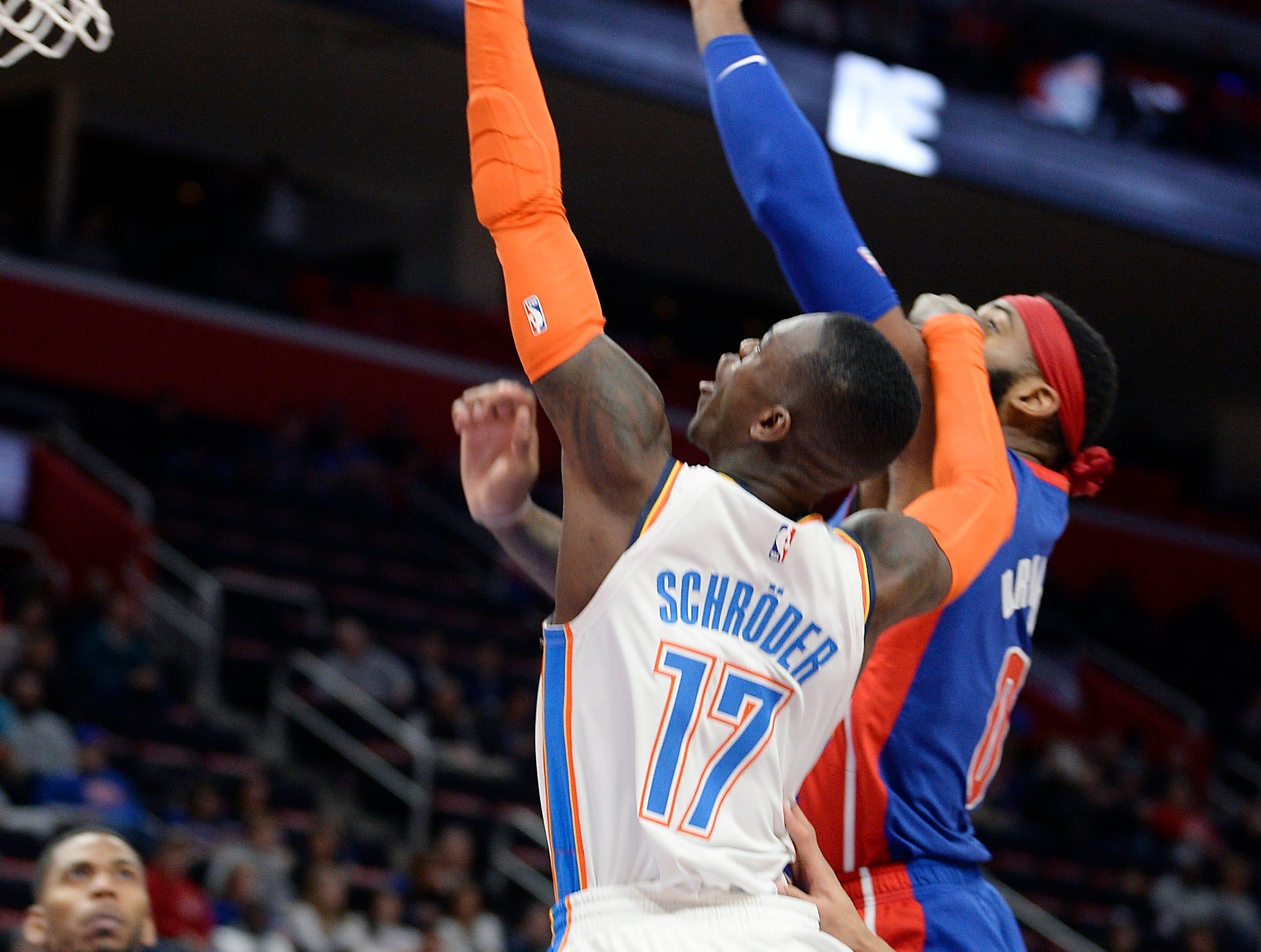 Thunder's Dennis Schroder scores over Pistons' Andre Drummond in the fourth quarter.