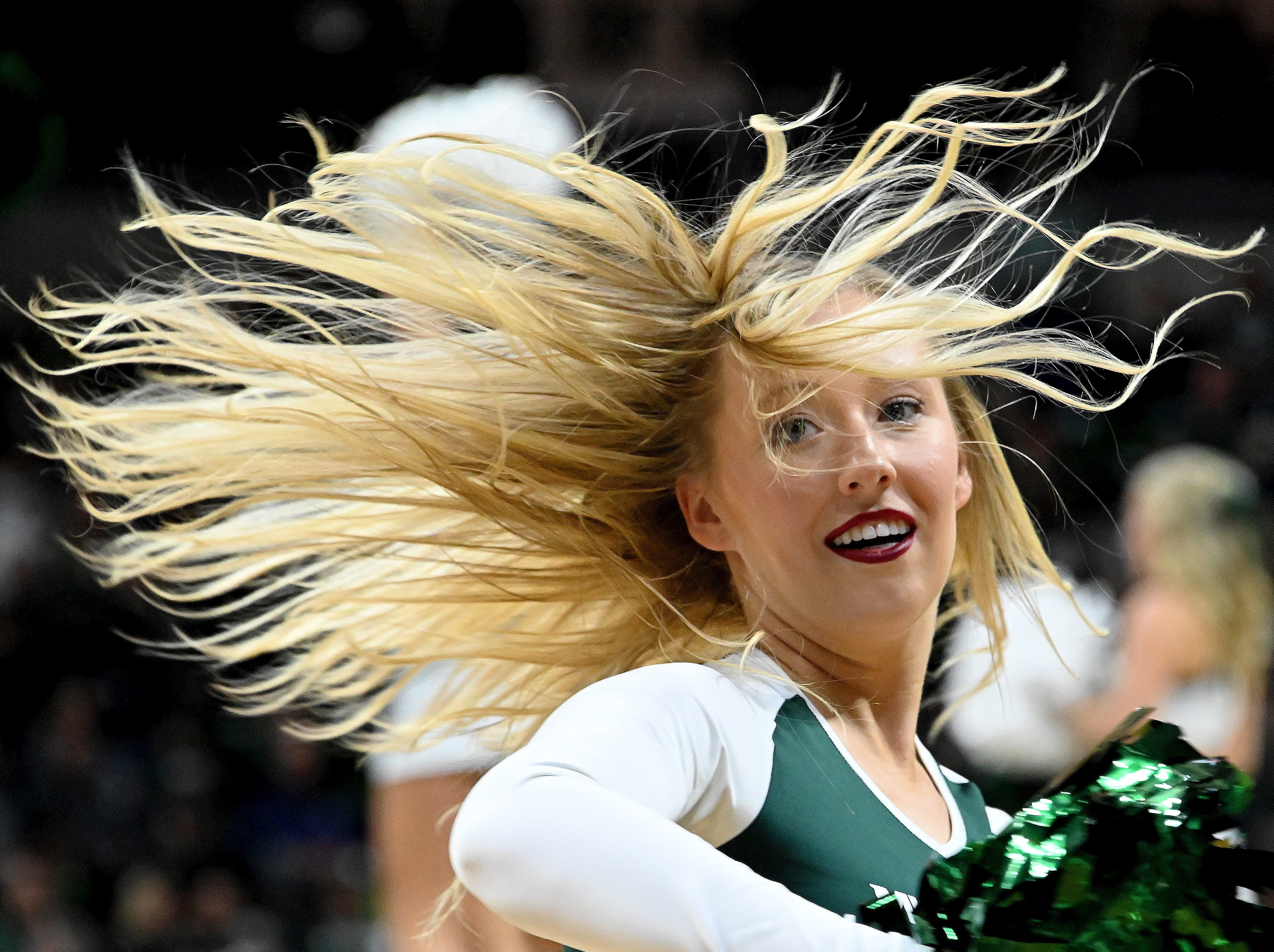 A solid twenty-point lead gave the cheer squad lots to twirl about as MSU beats Iowa 90-68, at Breslin center in East Lansing on Dec 03, 2018.