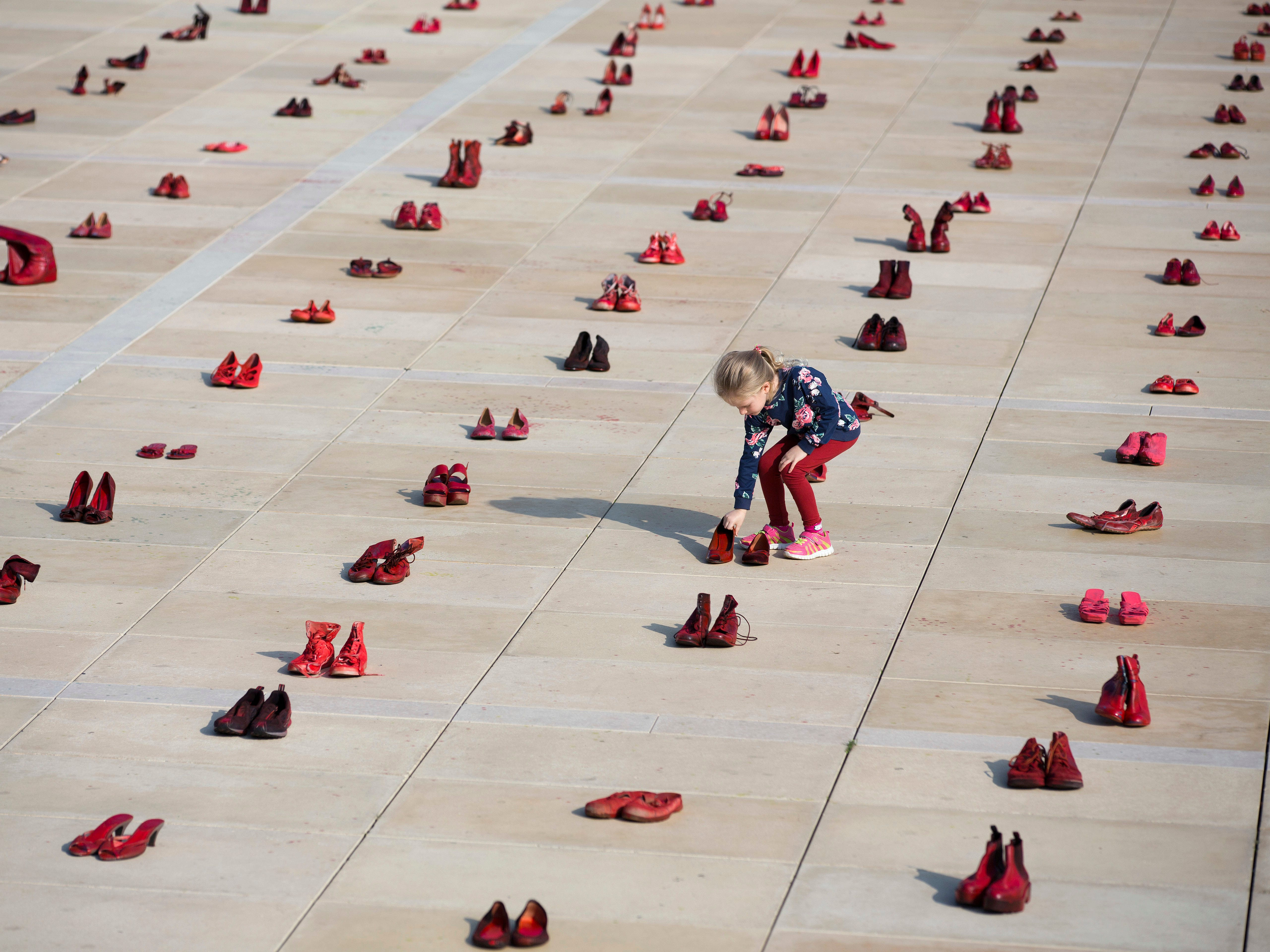 A display of hundreds of red shoes signifies protests against violence toward women in Israel at Habima Square in Tel Aviv, Israel, Tuesday, Dec. 4, 2018.