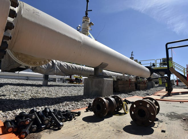 In this June 8, 2017 file photo, fresh nuts, bolts and fittings are ready to be added to the east leg of the pipeline near St. Ignace, Mich.
