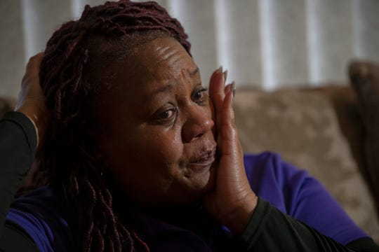 LaSondra Singleton wipes tears from her eyes as she talks about her son Kenneth Gross Jr. in her Warren home.  Kenneth died at age 12 waiting for a donor heart that failed due to complications from cancer.