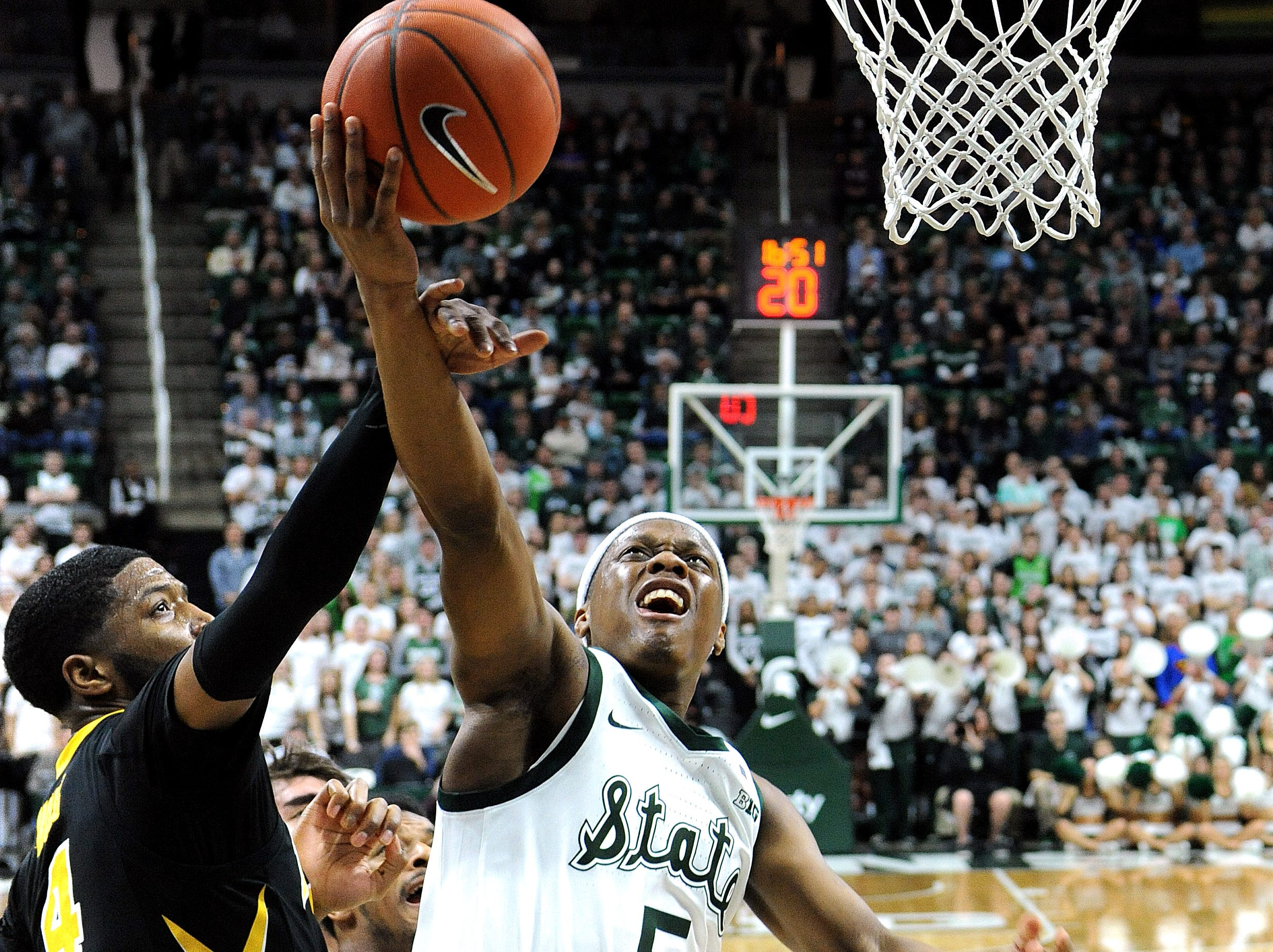 Cassius Winston gets fouled by Isaiah Moss (4) under the Spartan basket in the first half.