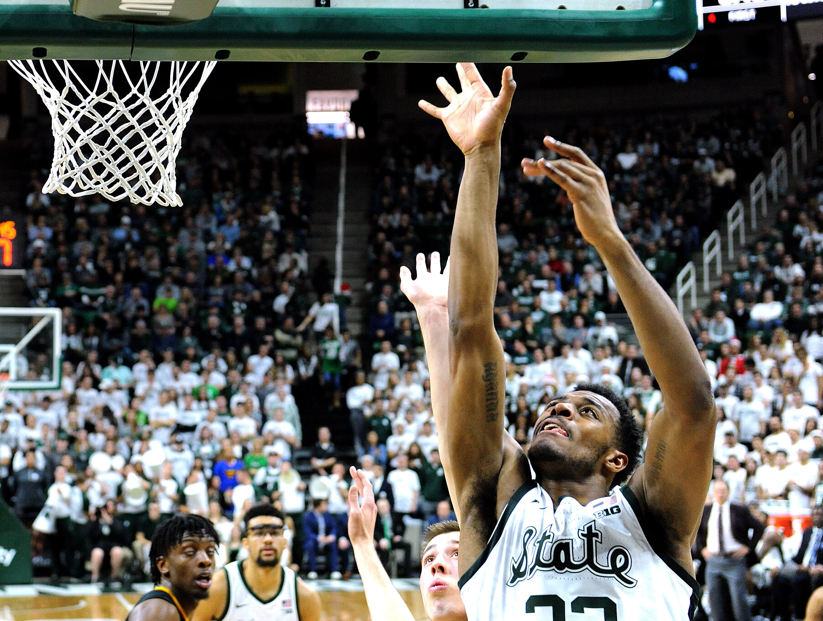 Xavier Tillman puts in a shot off the glass in the first half .