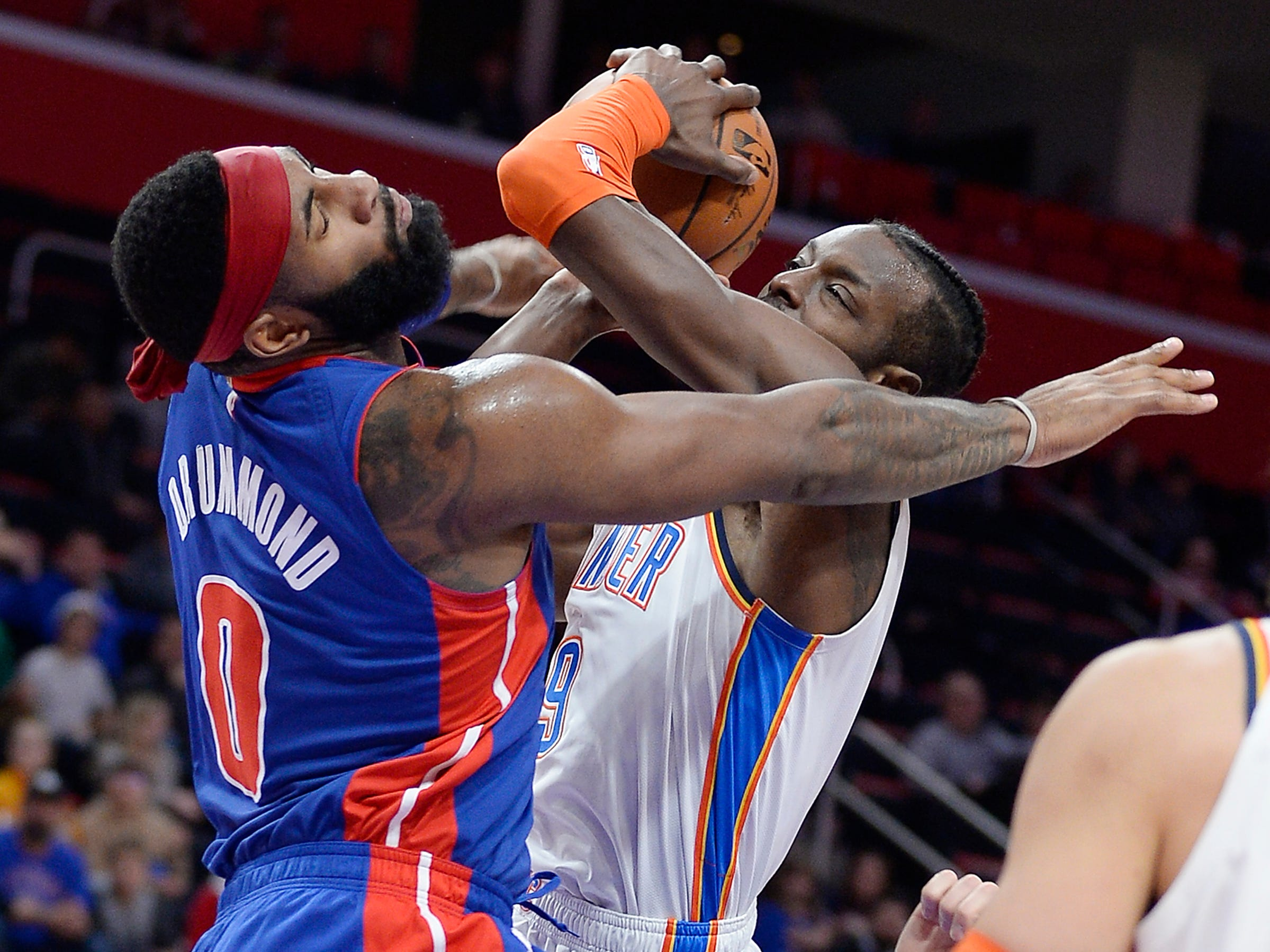 Pistons' Andre Drummond fouls Thunder's Jerami Grant in the third quarter.Drummond had 13 points and 6 rebounds. The Thunder defeated the Pistons 110-83, Monday, December 3, 2018 at Little Caesars Arena in Detroit, Michigan.