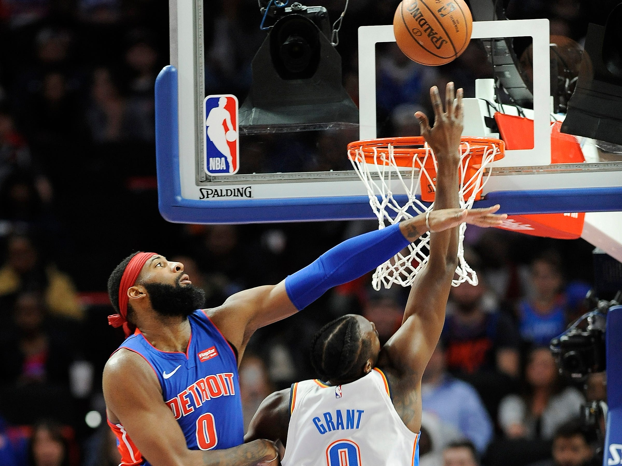 Thunder's Jerami Grant scores over Pistons' Andre Drummond in the second quarter.