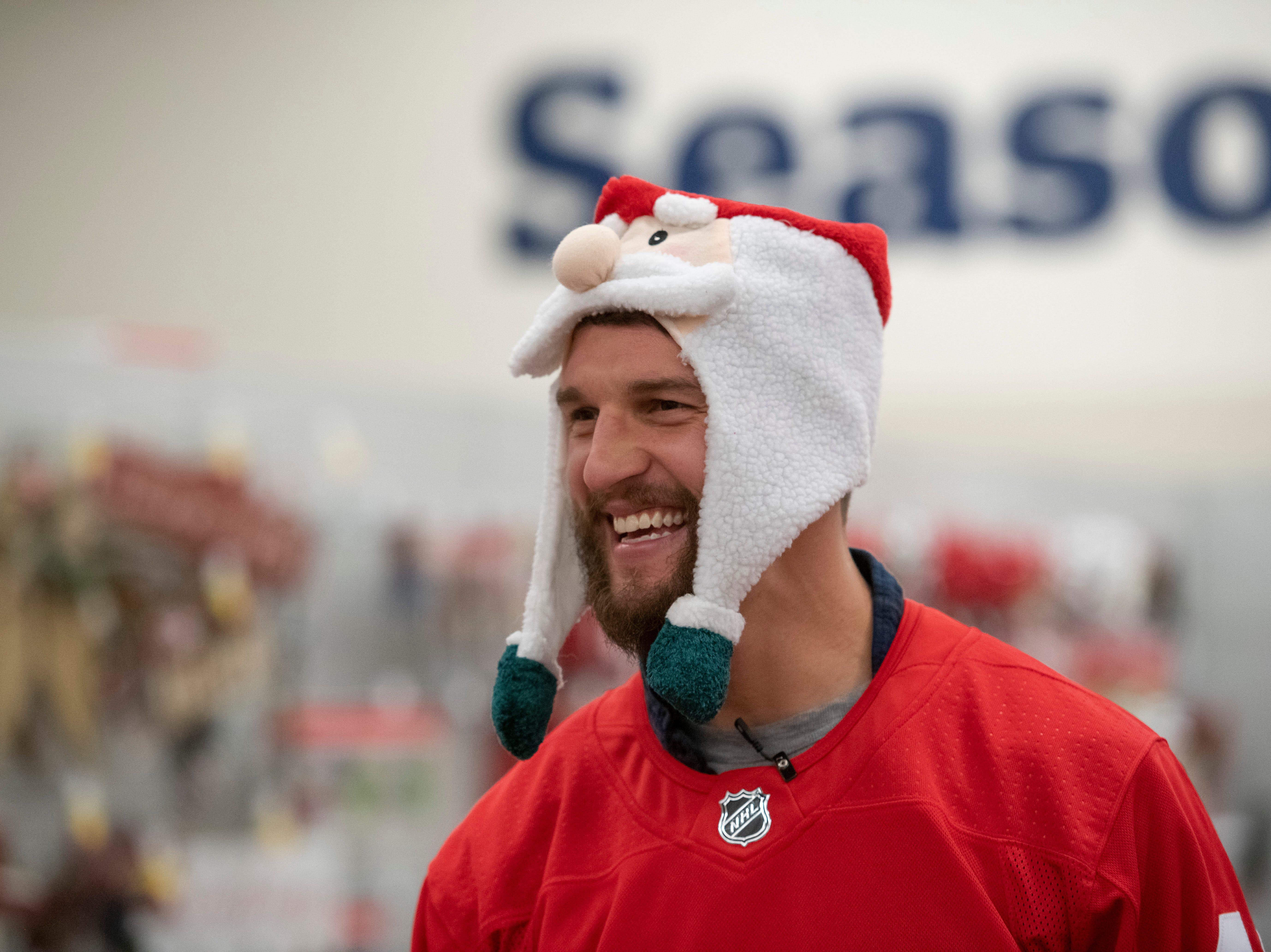 Detroit center Luke Glendening smiles during the team's annual Hometown Holiday Assist shopping spree.
