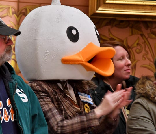 "Chanting demonstrators, including a man wearing duck head and a 'Lame Duck' name tag, jam the second floor of the Rotunda at the Michigan State Capitol building on Tuesday, December 4, 2018, protest legislation being considered in the ""Lame Duck"" sessions of the House and Senate."