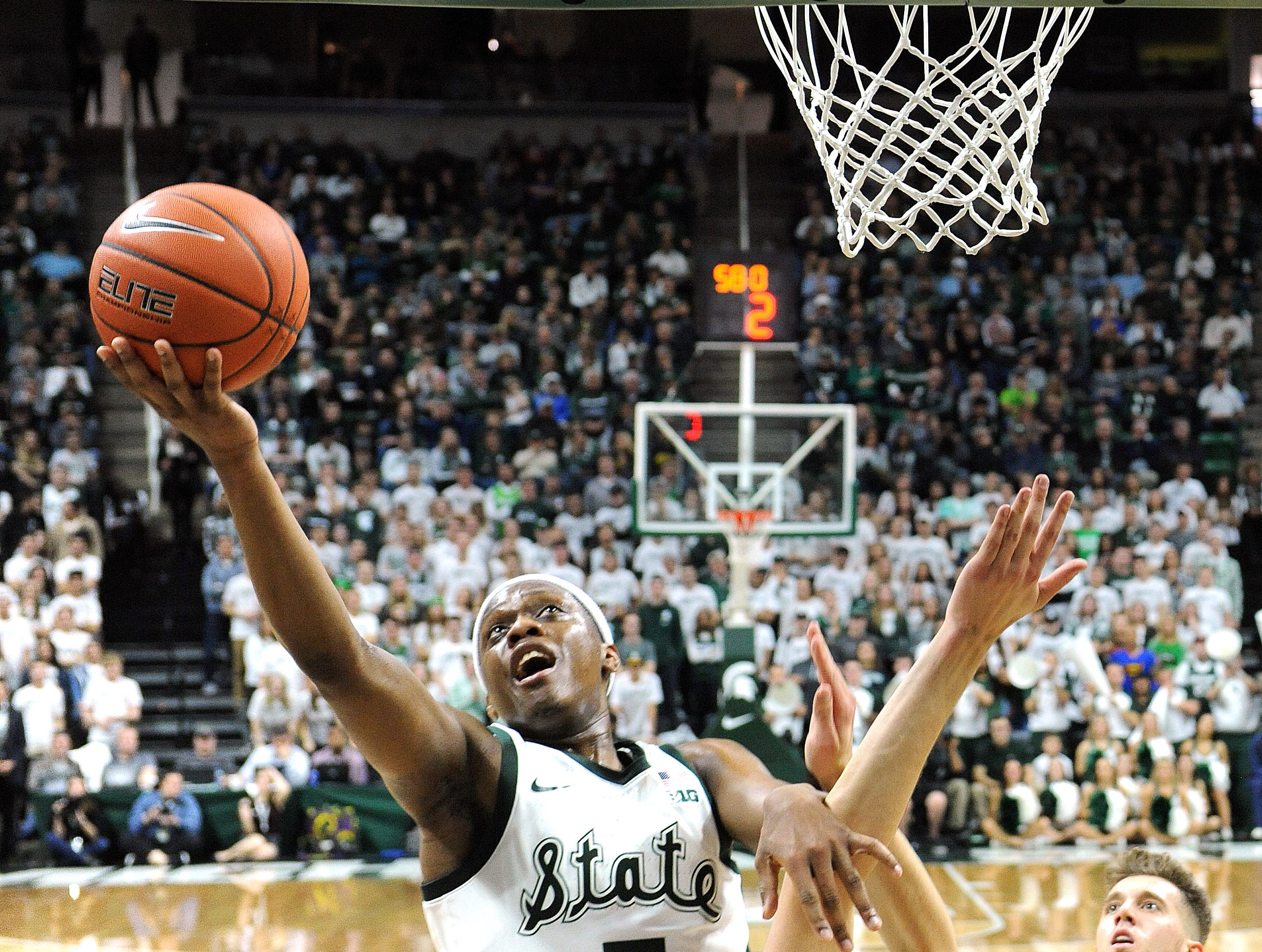 Cassisu Winston drives in, and scores off the glass in the first half.