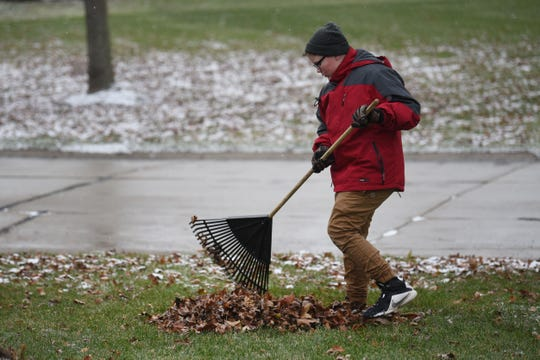 Kaleb Klakulak rakes leaves in Rochester Hills to raise money for a headstone for his best friend K.J. Singleton, who died of cancer last year.