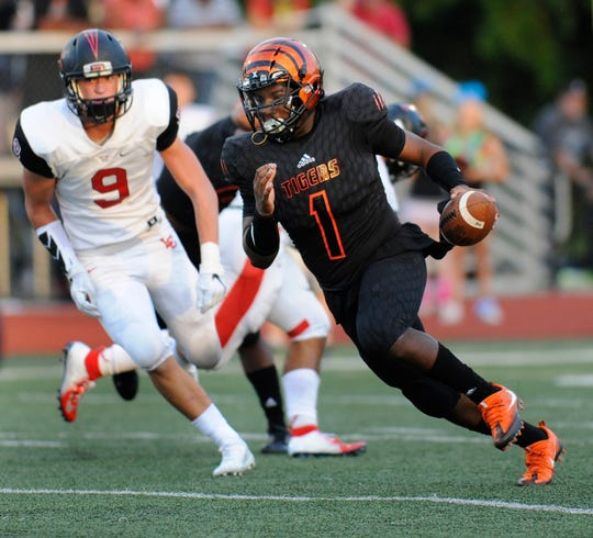 Belleville quarterback Christian Dhue-Reid (1) Dhue-Reid completed 76 percent of his passes (164-of-214) for 2,759 yards and 39 touchdowns with nine interceptions, rushing for five touchdowns.