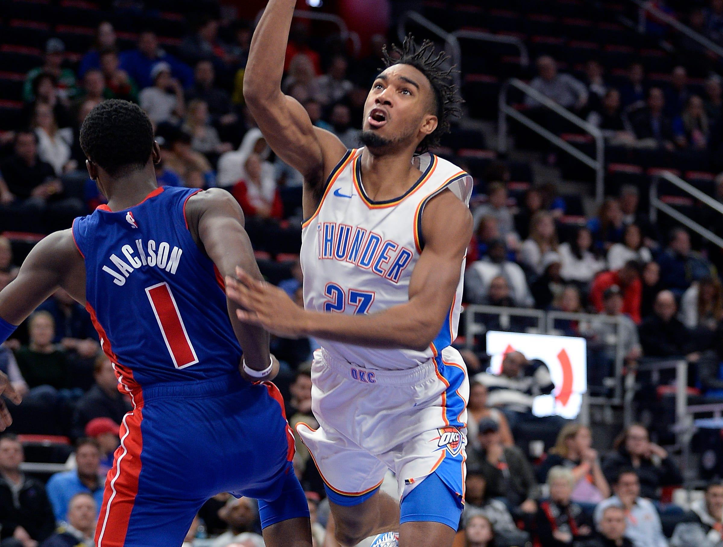 Thunder's Terrance Ferguson scores over Pistons' Reggie Jackson in the fourth quarter.