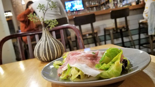 A Brussels sprout leaf salad with shaved country ham from The Freight House