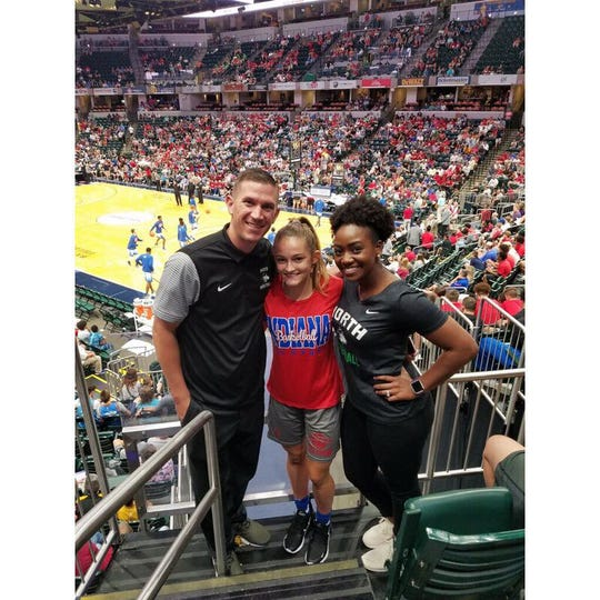 North girls' coach Tyler Choate and assistant Khristian Hart stand with 2018 Indiana All-Star Anna Newman.