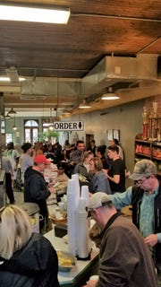 Hungry customers line up for lunch at the historic Kirchhoff's Bakery and Deli in Paducah, Ky. on Nov. 21, 2018