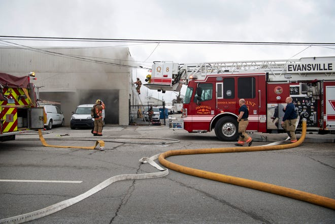 Evansville firefighters take on a fire at 1652 N. Fares Avenue at about 10:40 a.m. Tuesday. The flash fire was started accidentally by a worker who was working on a truck. The building houses the Dyna-Mechs Truck Service at 1650 N. Fares. Nobody was injured in the fire.