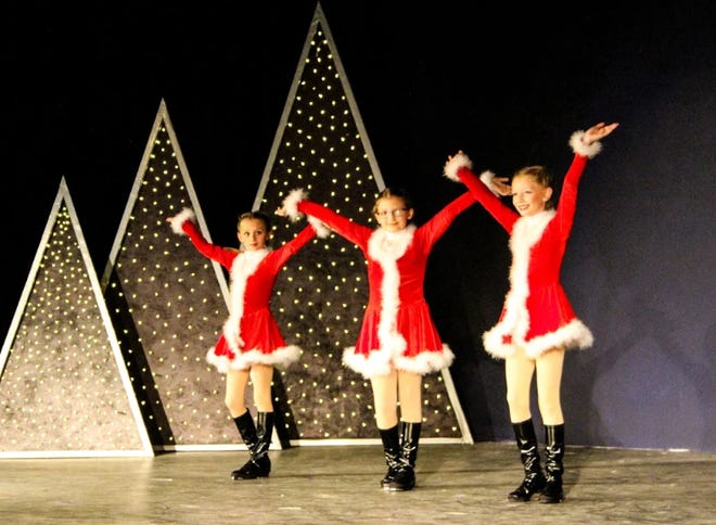 """From left, Emma Watson, Delayne Johnson, and Addison Laubacher are """"little tappers"""" who dance with elves during the Fremont Community Theatre's upcoming """"Joys of the Holidays."""""""