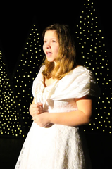 "Kenzie Franks sings during rehearsal for ""Joys of the Holidays,"" a Fremont Community Theatre production."