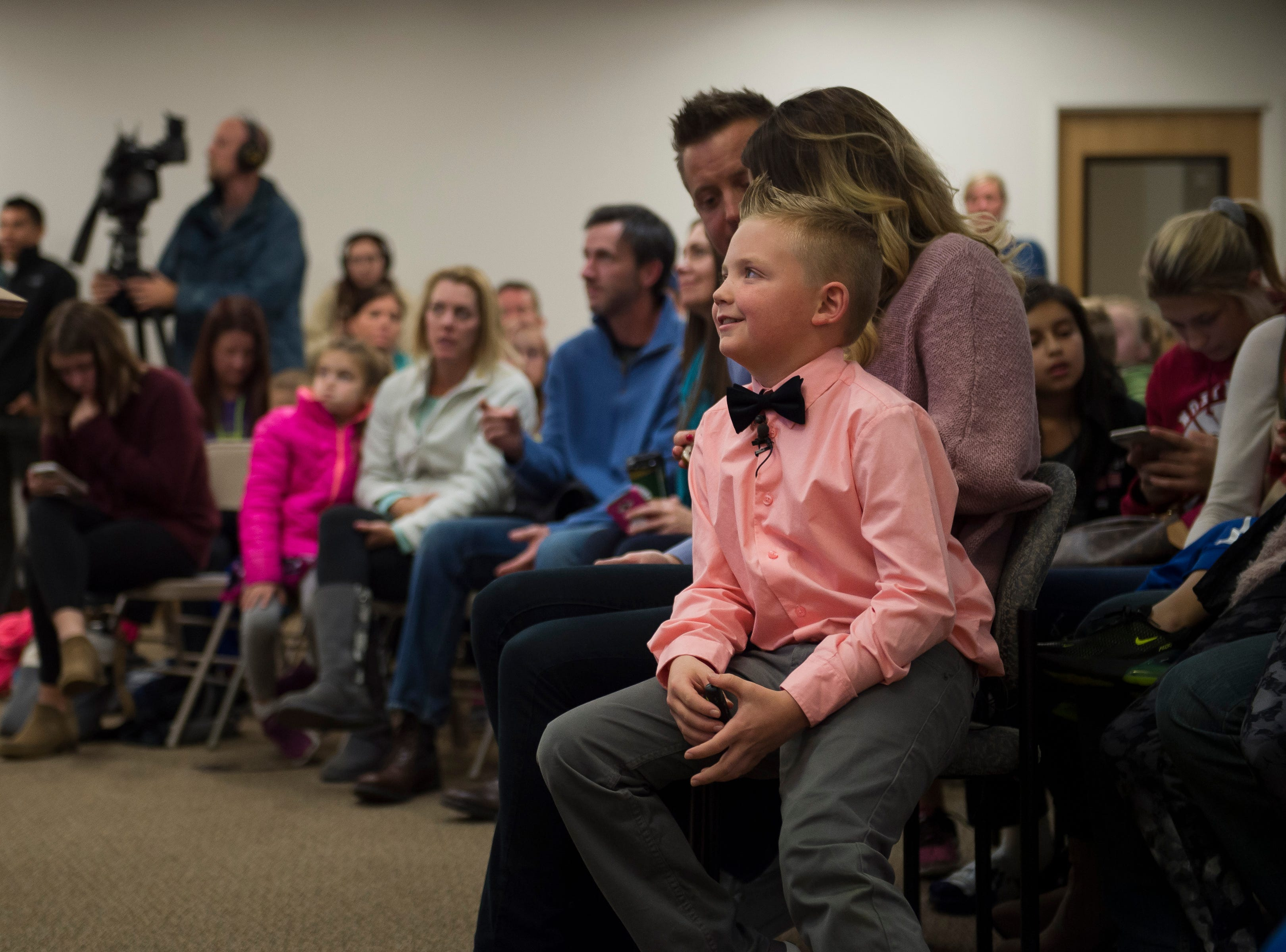 Range View Elementary School third grader Dane Best sits on his mother, Brooke Best's, lap during a town board meeting where he presented his argument to change a law in Severance that bans snowball fights on Monday, Dec. 3, 2018, at the Town Hall in Severance, Colo. The board voted unanimously to approve the law change.