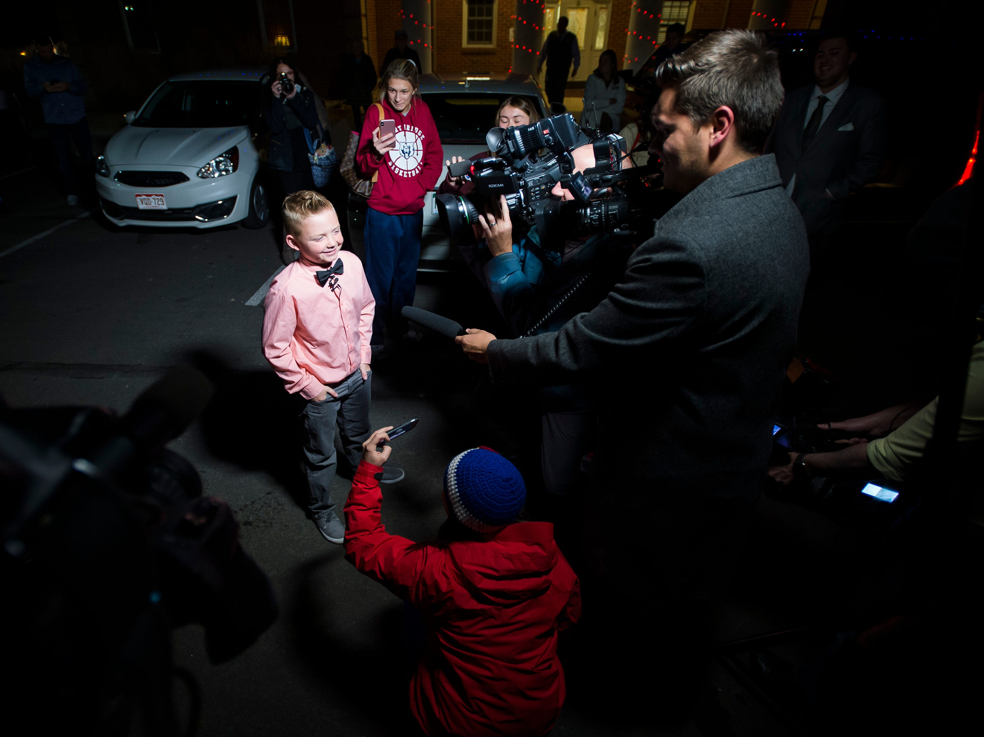 Range View Elementary School third grader Dane Best is interviewed by various media outlets after throwing the first legal snowball in the parking lot of the Town Hall after Dane presenting his argument to the town board trustees to change a law in Severance that bans snowball fights on Monday, Dec. 3, 2018, at the Town Hall in Severance, Colo. The board voted unanimously to approve the law change.