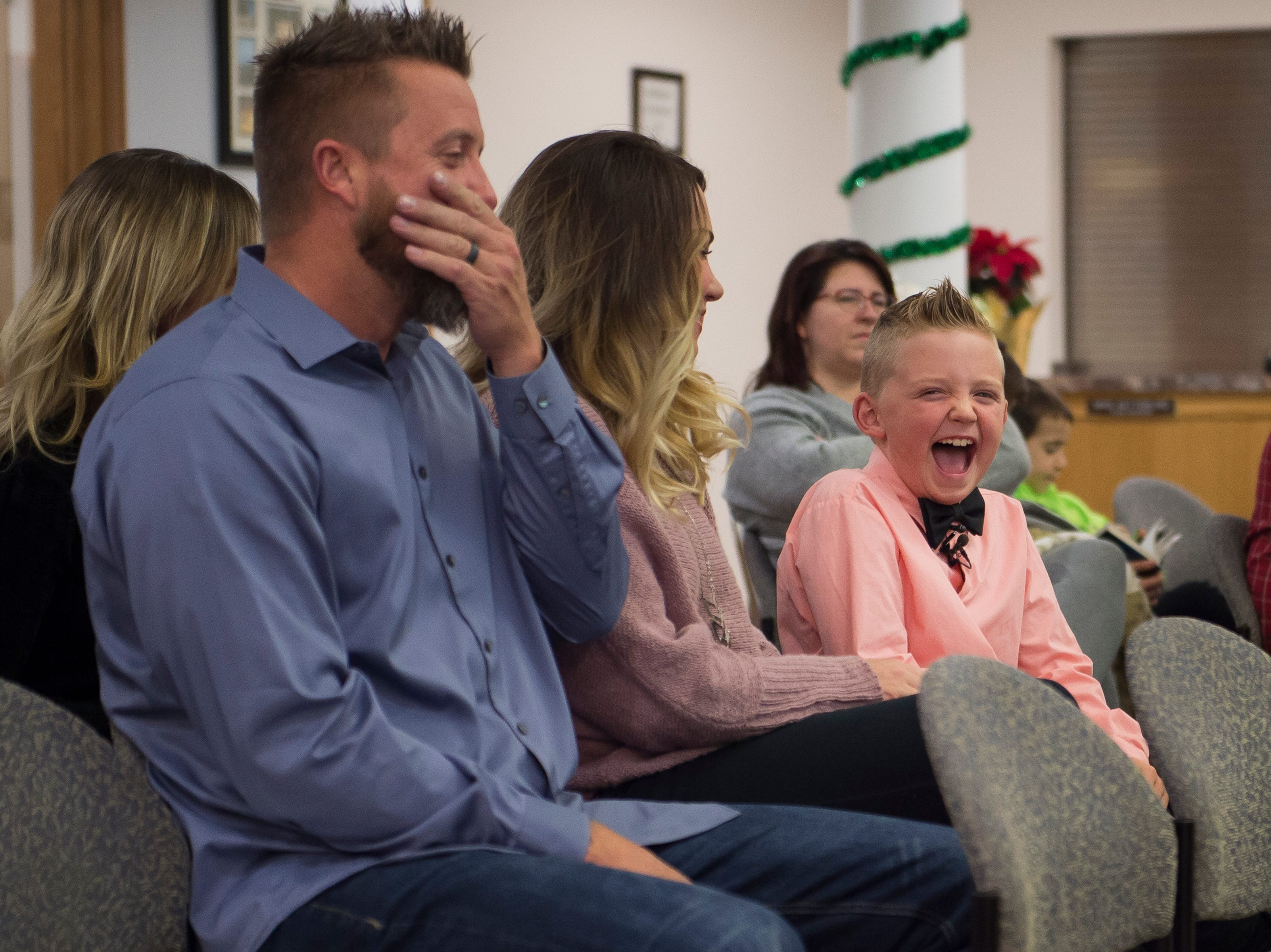Range View Elementary School third grader Dane Best laughs with his parents Brooke and Derrick before a town board meeting where he presented his argument to change a law in Severance that bans snowball fights on Monday, Dec. 3, 2018, at the Town Hall in Severance, Colo. The board voted unanimously to approve the law change.