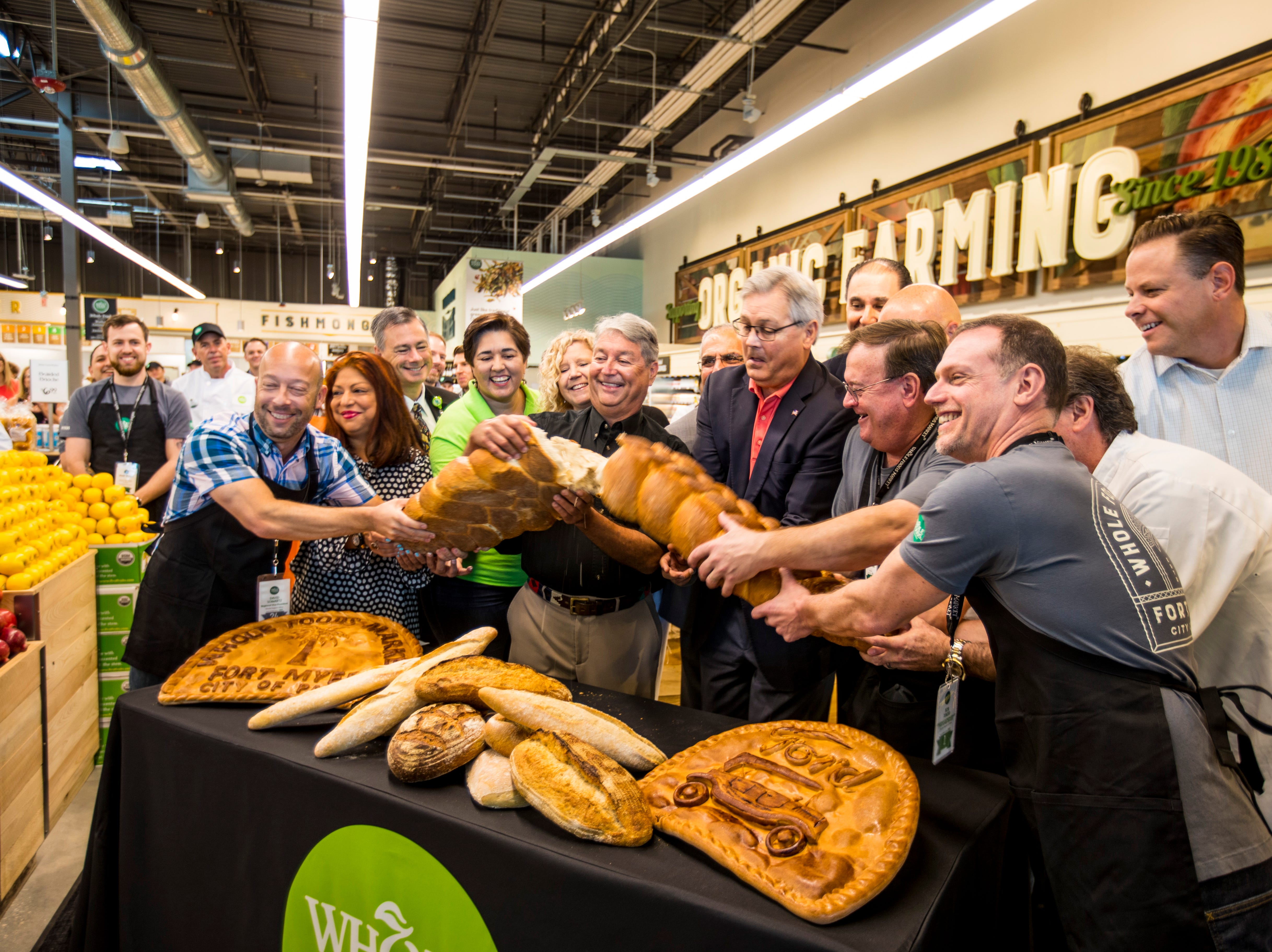 Instead of a ribbon cutting, Whole Foods breaks bread to officially open the store to the community. Whole Foods Market in South Fort Myers on the corner of Daniels and Six Mile Cypress opened on Wednesday morning to a crowd that wrapped around the building for hours.