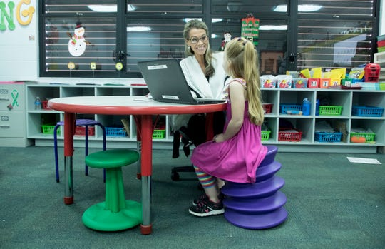 Gulf Elementary kindergarten teacher Brooke Przespolewski works with student Stormie Reifler, 5. The class uses flexible seating that allows students to make choices on seating. The classes offer several types of seating.  Przespolewski said she has seen an improvement in student performance.