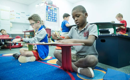Gulf Elementary School kindergartners Tyler Walker, 6, right, and Cooper Reitz, 5, use flexible seating in their class Monday, Dec. 3, 2018.