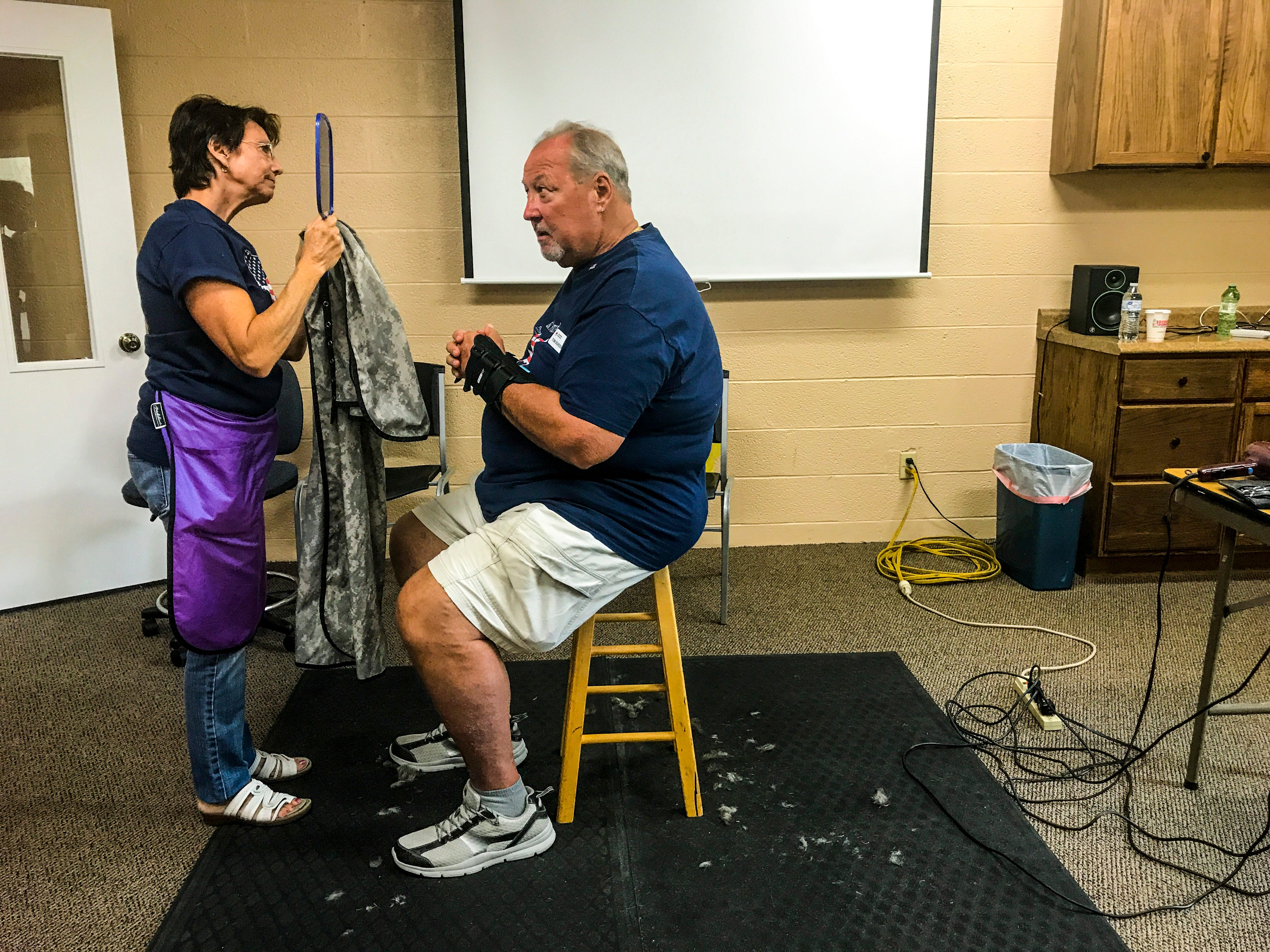 Tom Burden, volunteer with the Red Cross and Army Veteran from South Fort Myers, gets a haircut during the 7th Annual Military Appreciation Day, Saturday, Nov. 3, 2018, at First Christian Church on McGregor Blvd. in Ft. Myers. This was one of many services offered to the veterans. Tamara Hardy, with Shear Image Salon, offered free the cuts, along with Helen Appese, who volunteers her time to cut hair, as well.