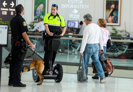 Airport police officers and Security Agents patrol Southwest Florida International Airport Tuesday around the noon hour. In November, Lee County commissioners acting as the airport board OK'd a three-year collective bargaining agreement between the airport police department and Teamsters Local Union No. 79. This is the first union-negotiated contract for the airport police department. It covers officers and security agents. The security agents are those folks who help direct traffic at the terminal, among other duties.