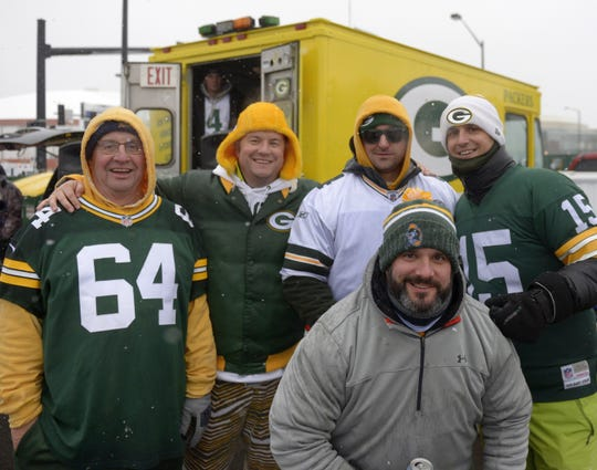 Back row from left, Terry Buboltz, Brett Buboltz, Ryan Keehan, Chad Buboltz, and in front, Bart Buboltz, all of De Pere, tailgate before the Green Bay Packers-Arizona Cardinals game on Dec. 2 at Lambeau Field in Green Bay.