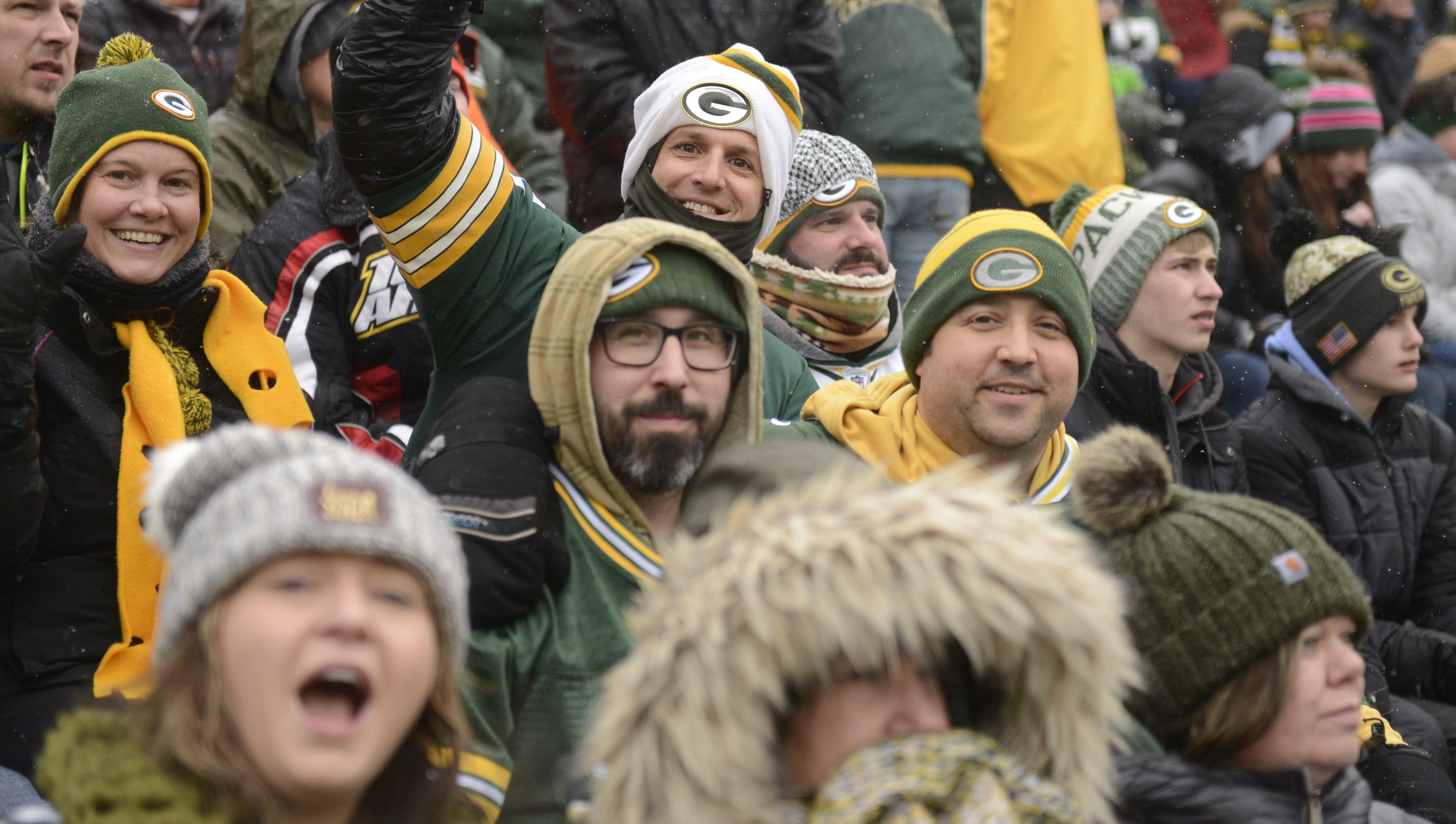 Chad Buboltz of De Pere, in white hat, sits among his season-ticket-holder friends in Section 103 at Lambeau Field during game against Arizona Cardinals, Dec. 2, 2018.