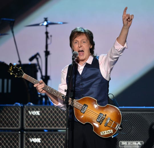 "Paul McCartney performs during ""The Night That Changed America: A GRAMMY Salute To The Beatles"" in 2014."
