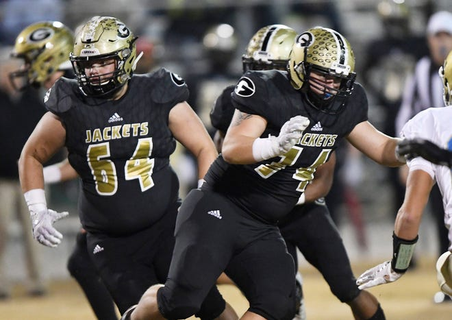 Offensive linemen Zach Drake (64), Chris Jackson (74) and the Greer Yellow Jackets will play Myrtle Beach in the Class AAAA state final Friday after the game was moved because of the threat of inclement weather.