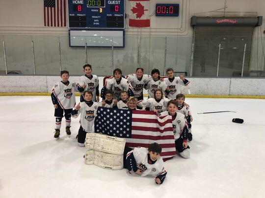 The 11 and under Carolina Rage team, poses for a photo after helping the US beat Canada in an international tournament in Detroit last week. The team includes players from across the Southeast, including Will Maness of Greenville, top right.