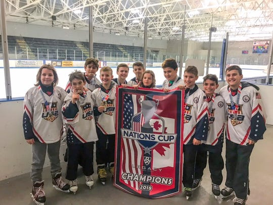 The 12 and under Carolina Rage team poses after helping the US beat Canada in an international youth hockey tournament in Detroit. Players from the Upstate are Dawson Anderson, far right; Brayden Youngblood, second from left; Nick Fabio, fourth from left; and James Parnell, sixth from left.