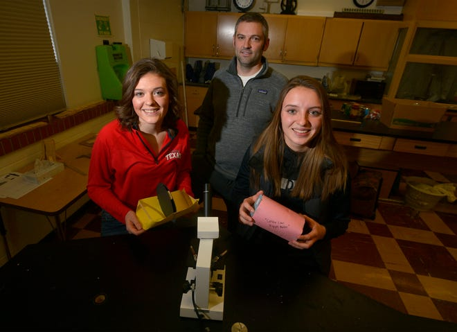 Mackenzie, left, and Madison Wiegand, both seniors at Simms High School, are finalist in the Samsung Solve for Tomorrow STEM contest.  The sisters, with guidance from Simms science teacher Jordan Hollern, center, designed a simple water purification system for people in under developed countries.