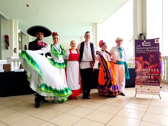 Dancing duos from Mexico, Finland and Costa Rica give local media a sneak peek of their colorful cultural performances at the Sheraton on Tuesday, Dec. 4.