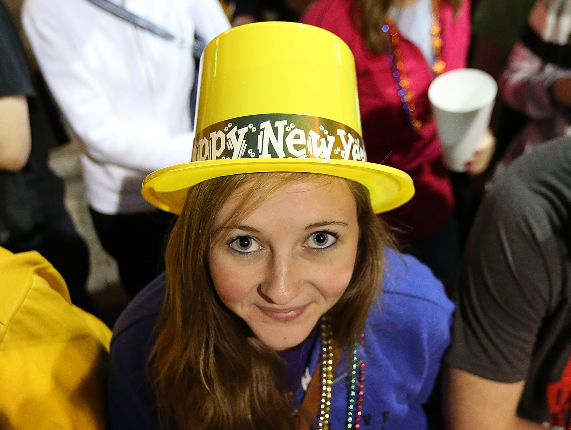 Hawkeye fan Torri Flickinger, 17, of Cedar Rapids shows her Hawkeye colors and festive spirit with a yellow New Year hat during the Outback Bowl parade on Tuesday, Dec. 31, 2013, in Tampa, Florida. (Bryon Houlgrave/The Register)