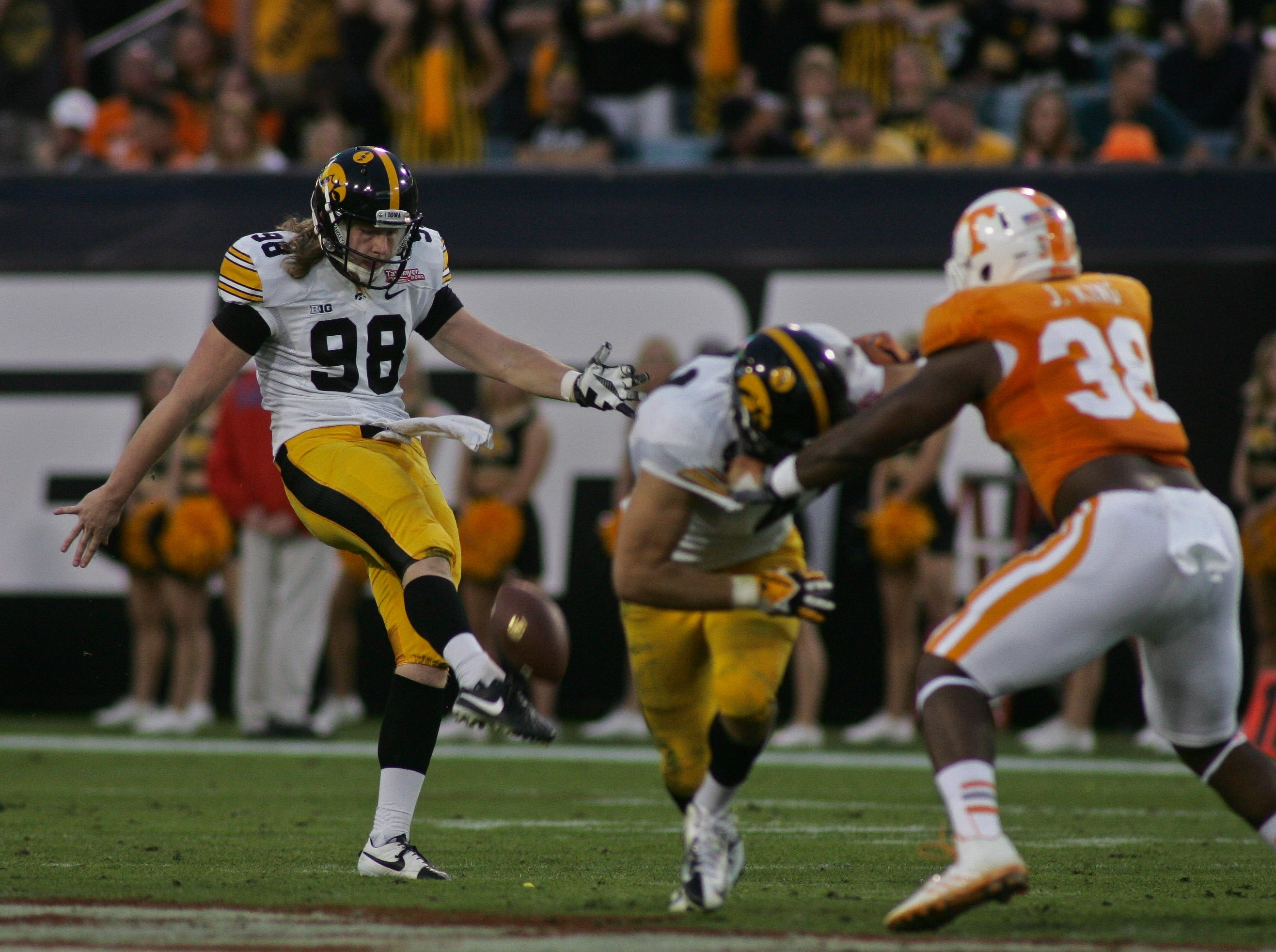 Jan 2, 2015; Jacksonville, FL, USA; Iowa Hawkeyes punter Connor Kornbrath (98) punts the ball in the third quarter of the 2015 TaxSlayer Bowl against the Tennessee Volunteers at EverBank Field. The Tennessee Volunteers beat the Iowa Hawkeyes 45-28. Mandatory Credit: Phil Sears-USA TODAY Sports