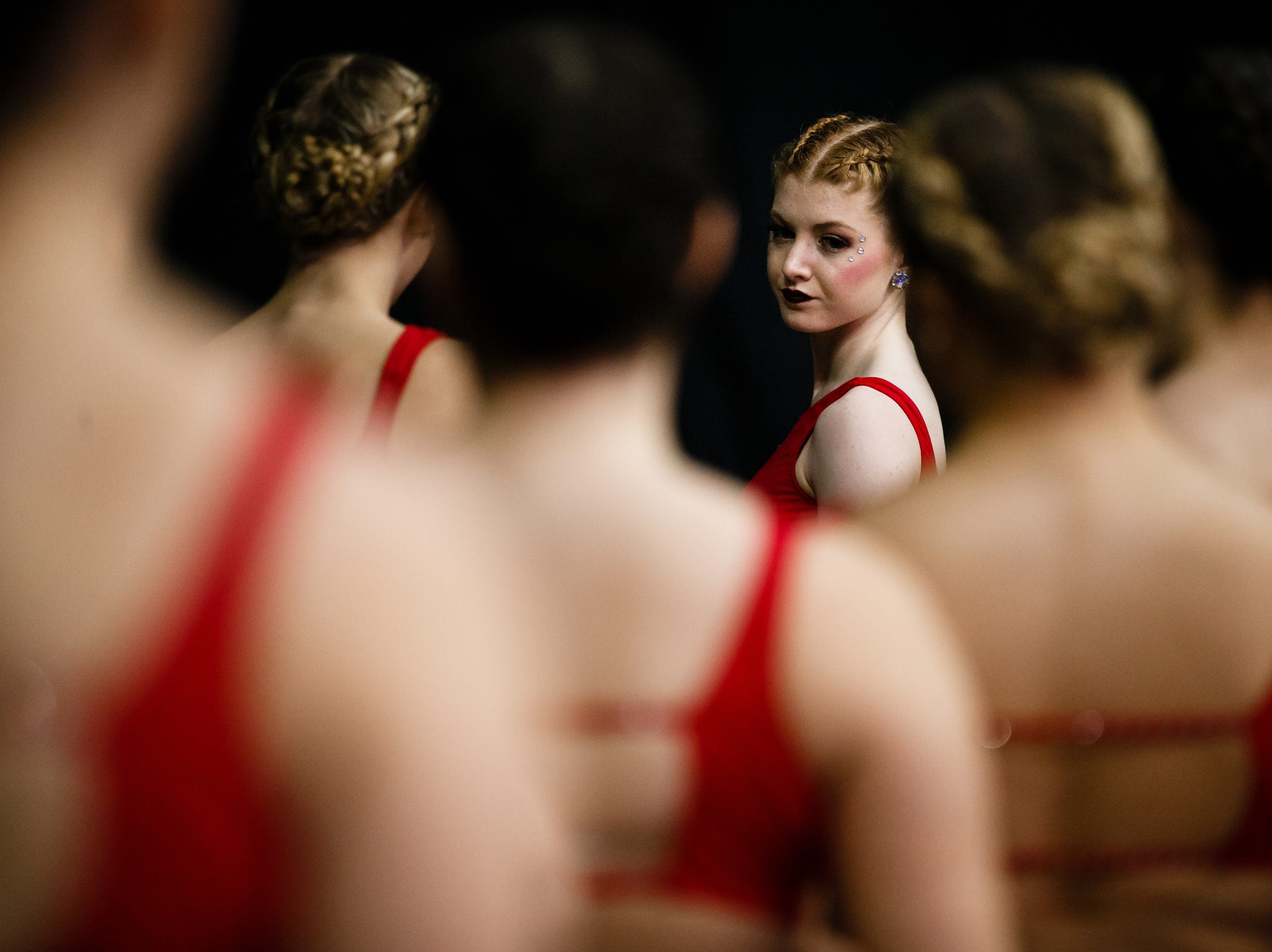 Dancers warm up before performing at the Iowa Dance State Championships at Wells Fargo Arena on Friday, Nov. 30, 2018, in Des Moines.