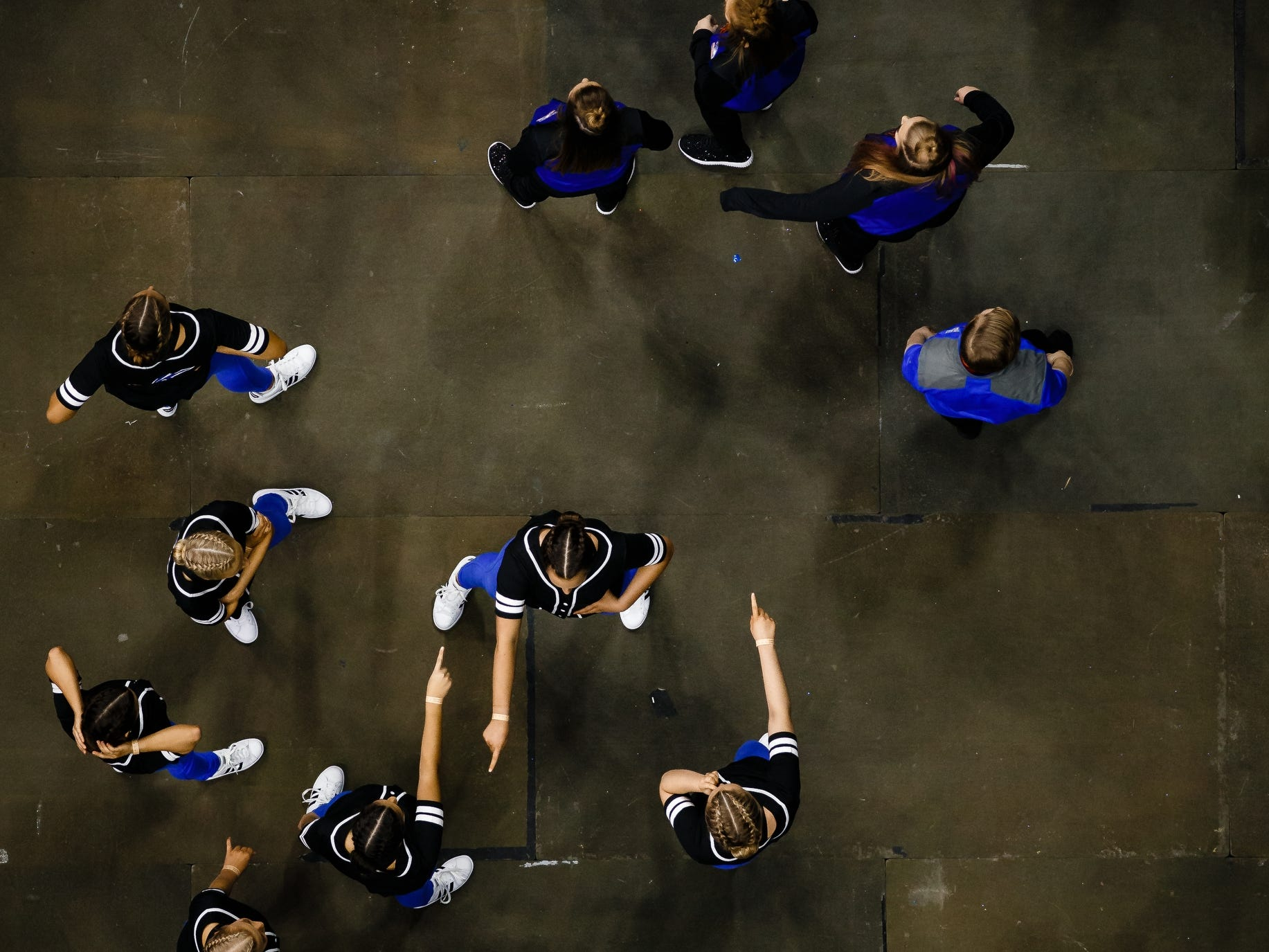 Teams warm up before performing at the Iowa Dance State Championships at Wells Fargo Arena on Friday, Nov. 30, 2018, in Des Moines.