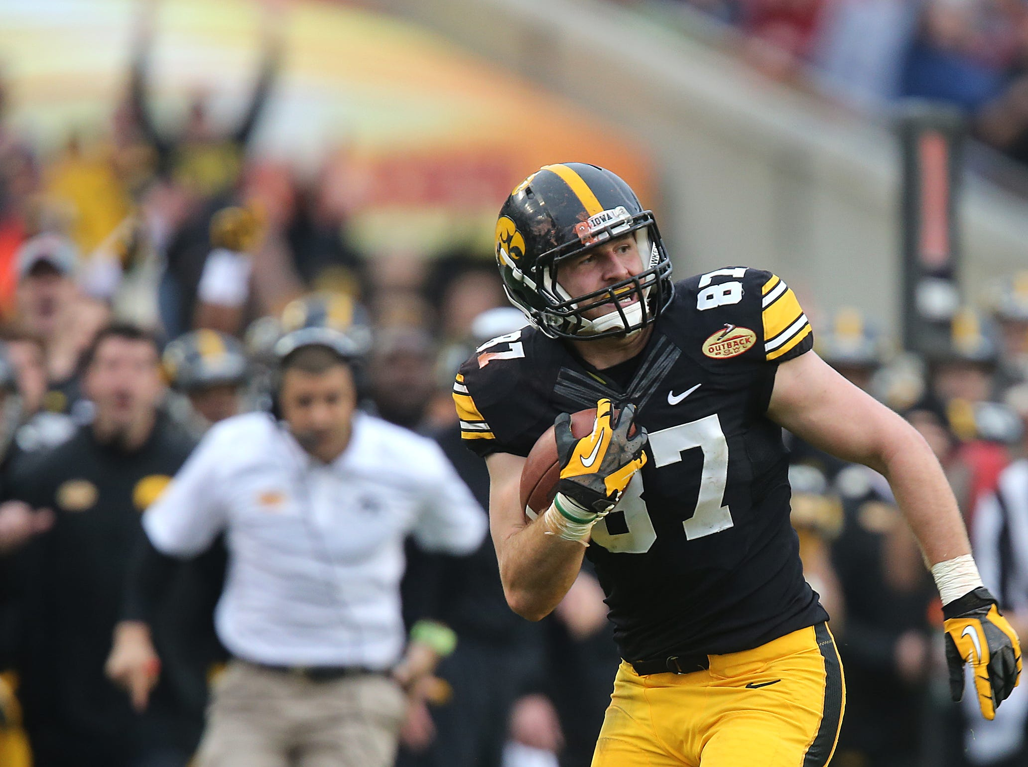 Iowa tight end Jake Duzey makes a reception in the fourth quarter against LSU in the Outback Bowl on Wednesday, Jan. 1, 2014, in Tampa, Florida. (Bryon Houlgrave/The Register)