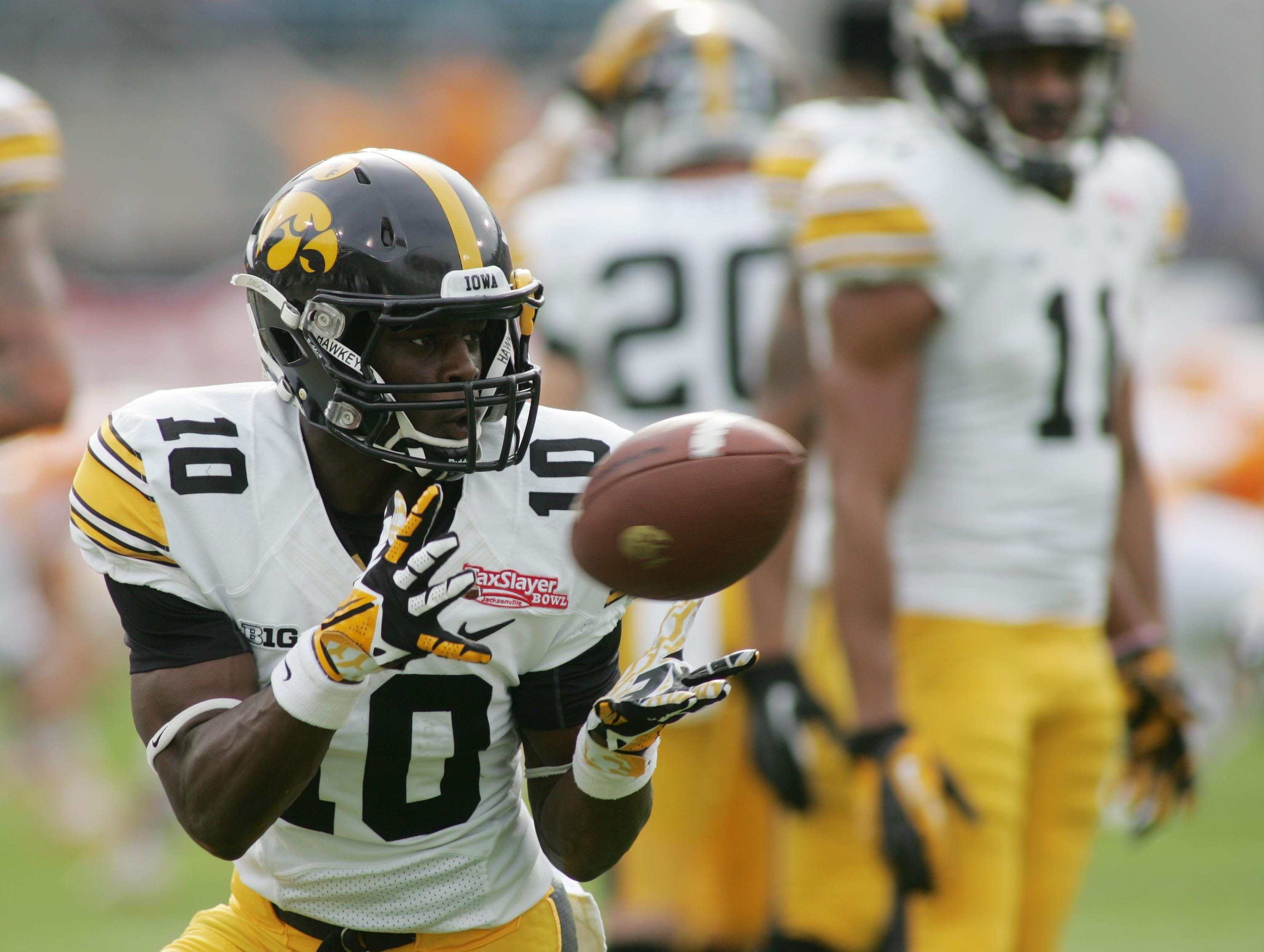 Jan 2, 2015; Jacksonville, FL, USA; Iowa Hawkeyes running back Jonathan Parker (10) catches a pass before the start of their game against theTennessee Volunteers in  the 2015 TaxSlayer Bowl at EverBank Field. Mandatory Credit: Phil Sears-USA TODAY Sports