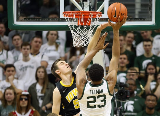 This scene played out far too often for Iowa's liking in the first game this season against Michigan State: Spartans forward Xavier Tillman laying the ball in over the Hawkeyes' Nicholas Baer. Michigan State made 21 layups and bruised the Hawkeyes with a 90-68 win. The teams meet again Thursday in Iowa City.